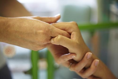 A GOSH patient and Occupational Therapist's hands