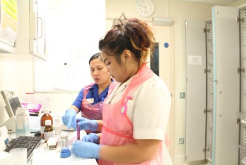 Nurses preparing medicine on Butterfly Ward