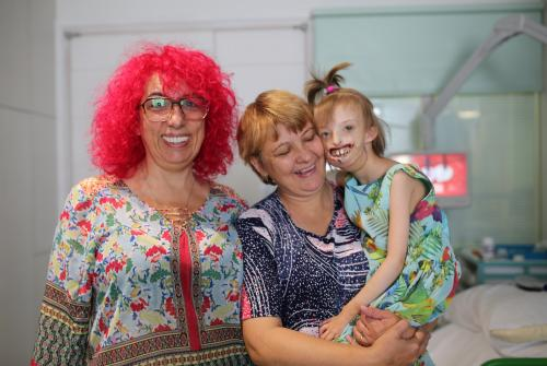 Ella, from Anglomedical, Elena and her daughter Darina at GOSH